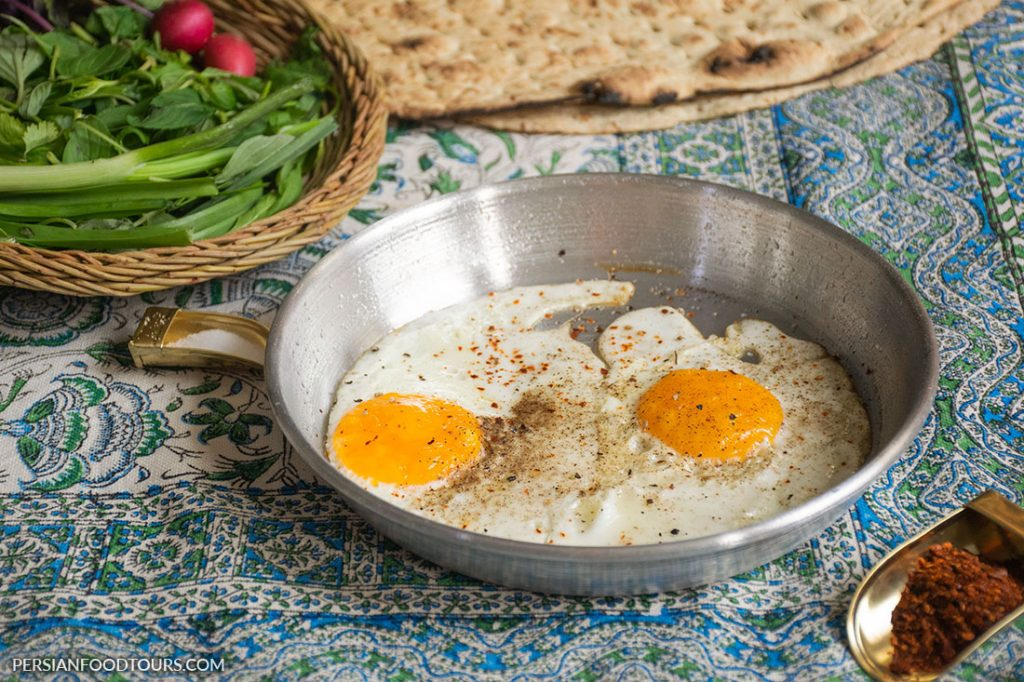 Fried eggs with bread and herbs-Persian breakfast